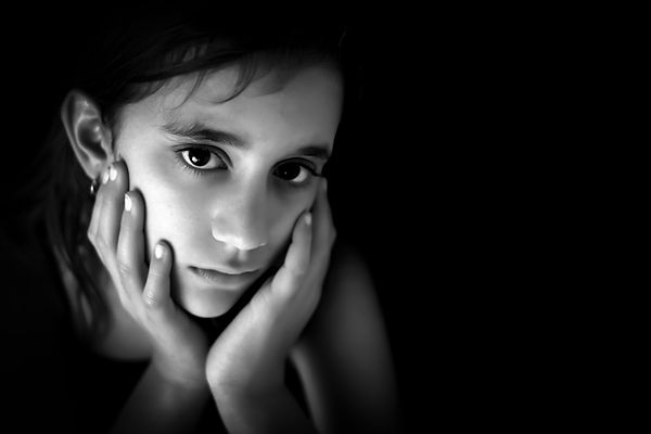Sad Hispanic teen girl. Represents the need for teen depression counseling in katy tx 77494. Also represents the need for teen substance abuse counseling in katy, tx and houston.