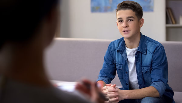 teen boy talking with counselor. Represents a teenager in teen counseling houston, tx. Could also be teenager in teen depression counseling in katy tx 77494.