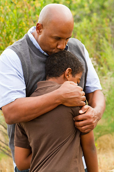 Son comforting father in field. Represents teen depression counseling in houston texas. Also represents gifted student and talented teen athlete needing therapy for anixety in katy texas 77494.