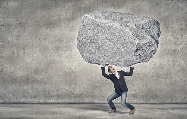 Teen boy holding up a boulder over his head. Represents teen depression being heavy and needing a therapist for teen depression. There is therapy for teen depression in katy texas and therapy for teen depression in houston texas. 77494.