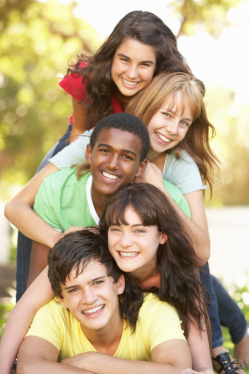Teen friends stacked on top of each other smiling. Represents the happiness that teen counseling in katy texas and teen counseling in houston texas can bring. Family therapy in katy texas and family therapy in houston texas can help.