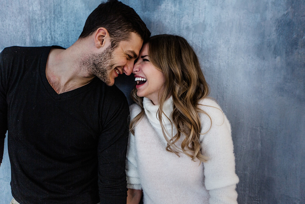 Man and woman smiling with foreheads touching. Represents the need for marriage counseling katy, tx 77494 and couples therapy katy, tx 77494.