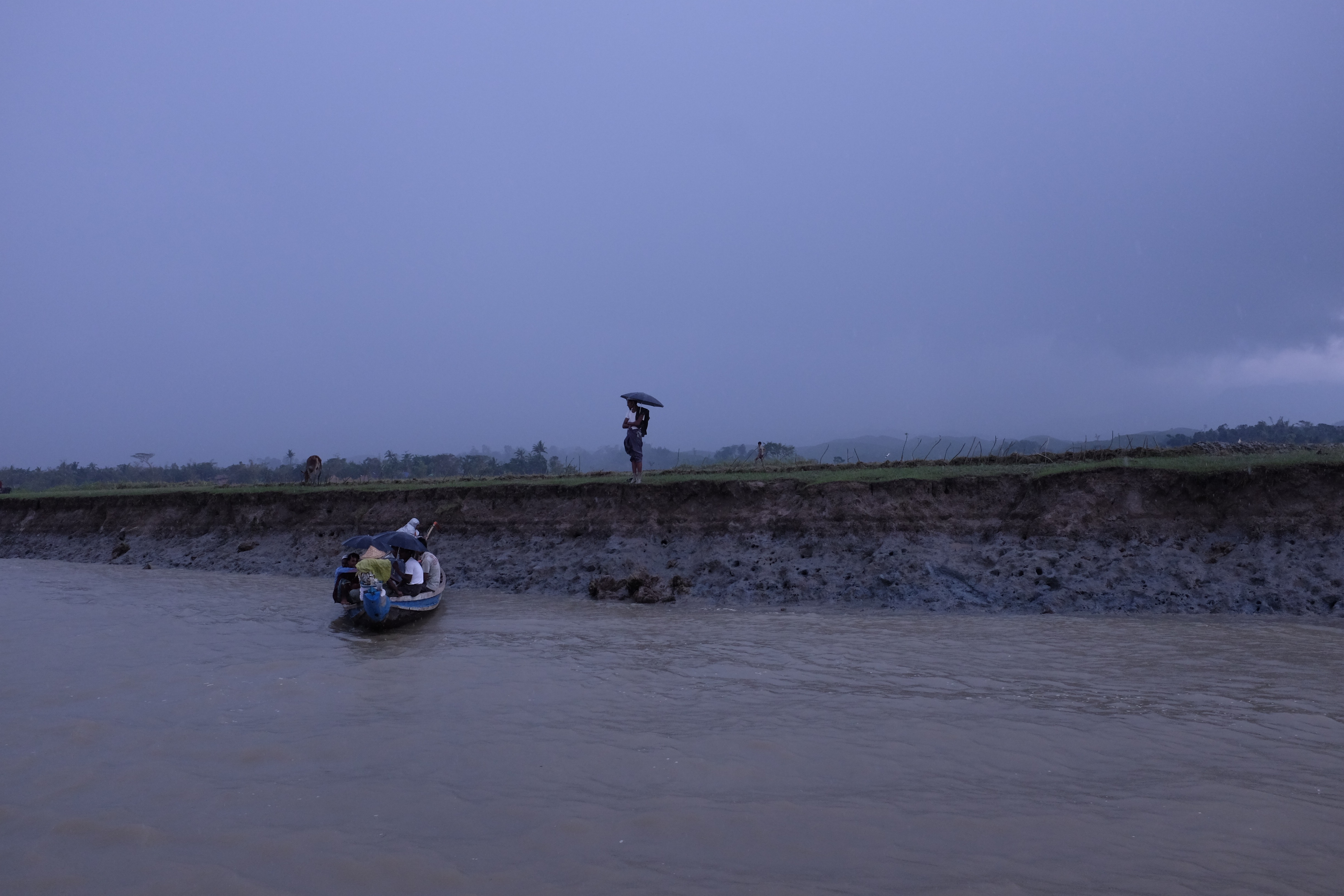 Muslim villagers seen from the ferry to Buthidaung which neighbours Maungdaw Township in the wake of