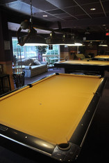 Players Billiards view of the pool hall from table 19. In the picture you will see a Brunswick Gold Crown III with green 860 Sinomis cloth.