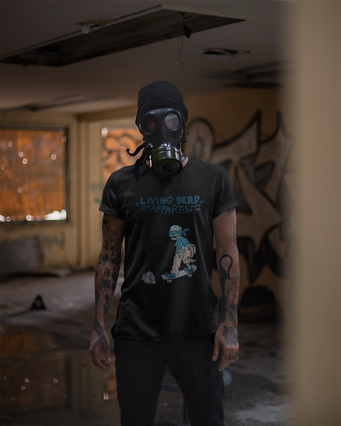 A man with a face mask or gas mask wearing a Living Dead Apparel t-shirt with zombie and skateboard