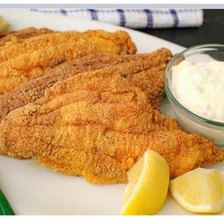 Fried Fish with Lemon Wedges