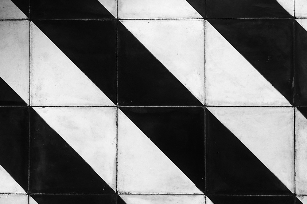Black & white diagonal stripes on subway tiles