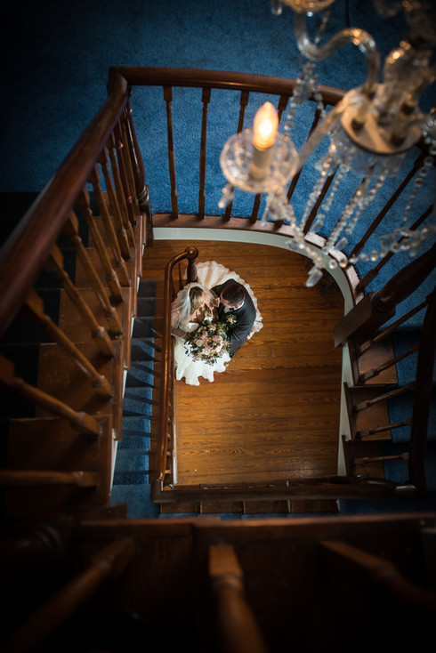Couple under a stair case