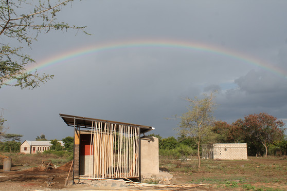 Rainbow behind the toilet block