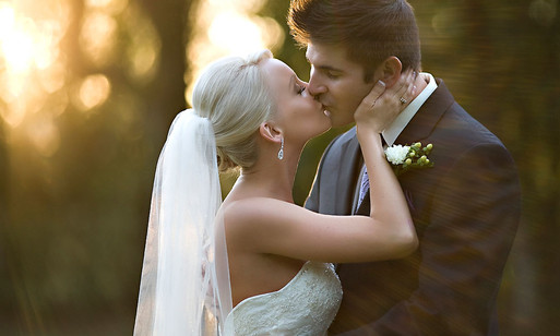 The best time of day for wedding portraits is the magic hour. Wedding kiss by photographer, Inga Finch of Tallahassee Florida