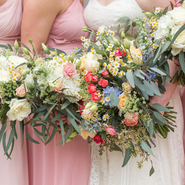 Colorful wildflower wedding at Pebblehill Thomasville by A Country Rose Florist.