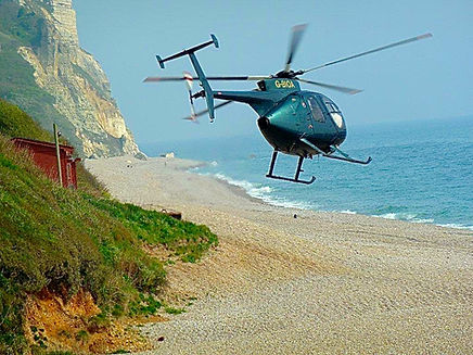 Helicopter taking off from beach