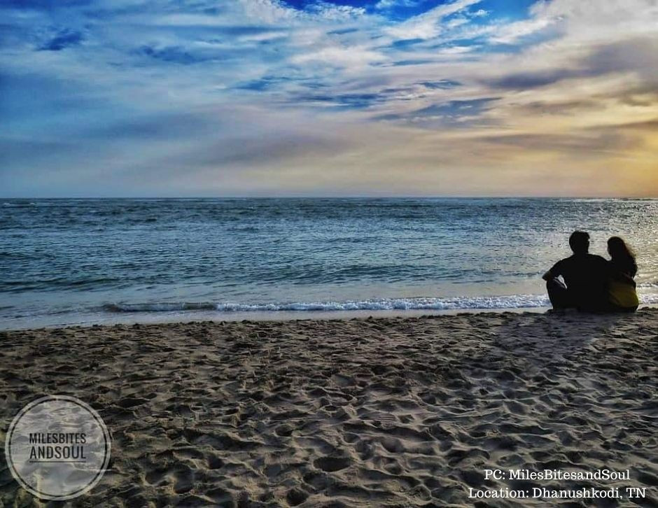 Mridula and Rahul relaxing by the quiet Dhanushkodi beach in Tamil Nadu.