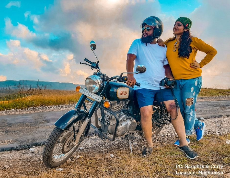 Diana & Donald posing with their Bike which they took on a road trip in Meghalaya