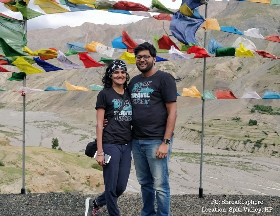 Shreya and Akshay are posing against a lovely backdrop of colorful flags in Spiti Valley, HP