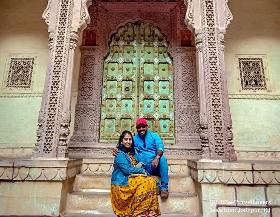 Zenia and Bhal posing in front of an ornate door in the Mehrangarh fort in Jodhpur.