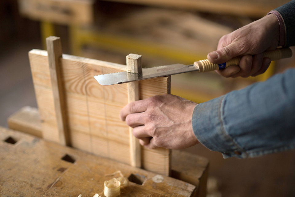 Carpenter Cutting Wood