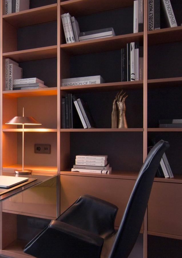 Backlit bookcase in satin copper - design R&D De Castelli