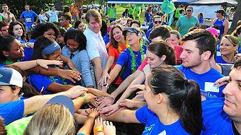 volunteer hands in.jpg