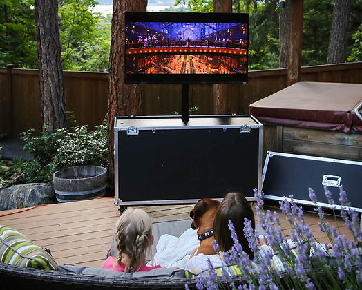 The X1Mobil is a mobile TV unit for any and all display needs. X1Mobil being used outdoors to watch a movie by the hot tub. Made with the best available TV Lifts in Canada. The X1Mobil is fully customizable with a multitude of materials, colors, and sizes.