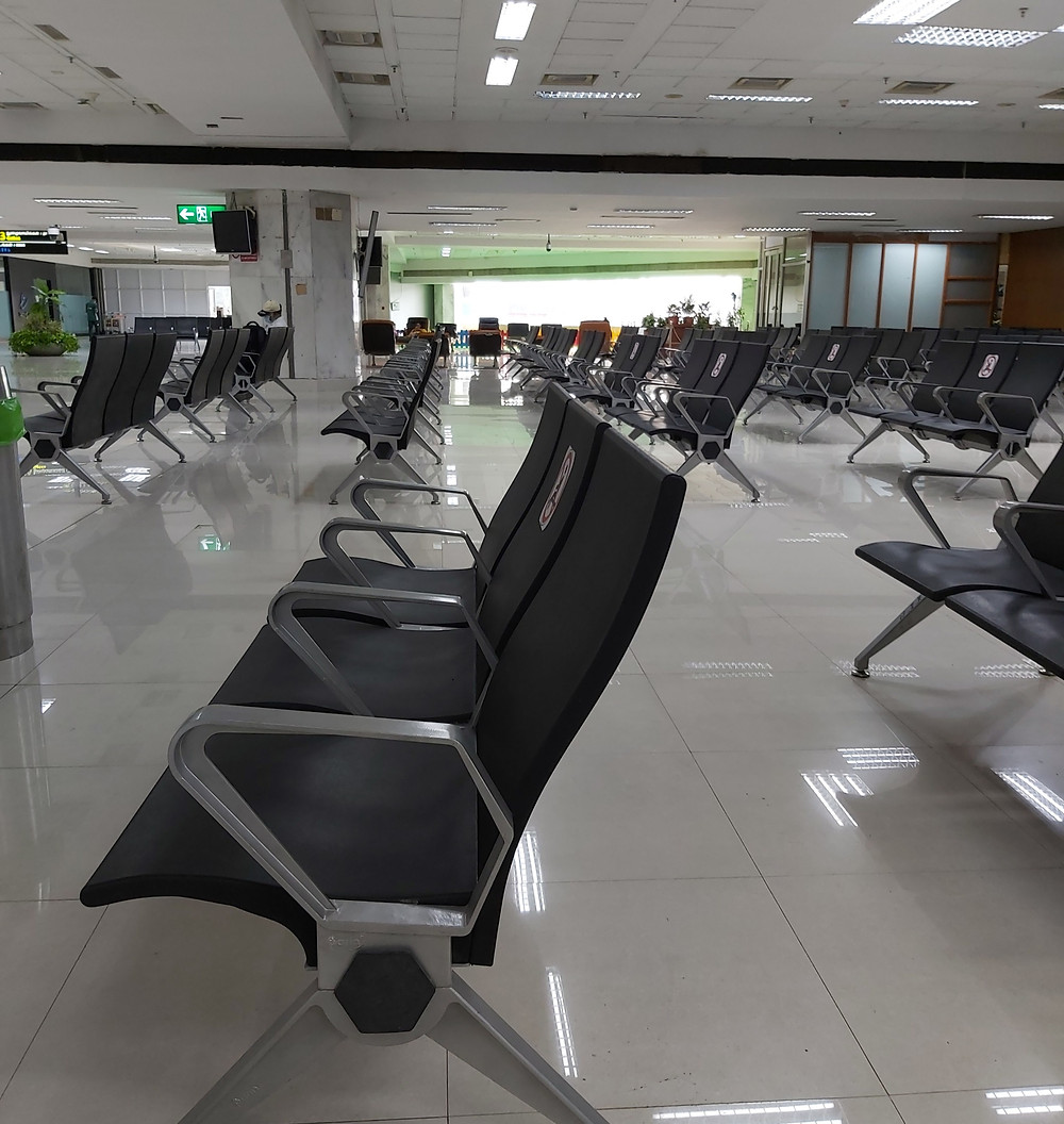 row after row of empty chairs at chennai airport