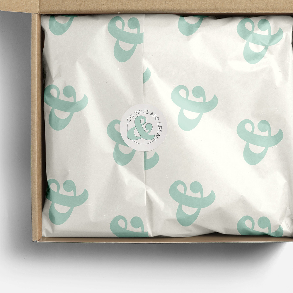 Tissue paper and sticker design for a bakery.