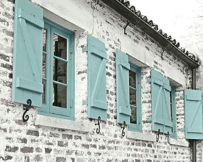 aqua shutters and farmhouse windows