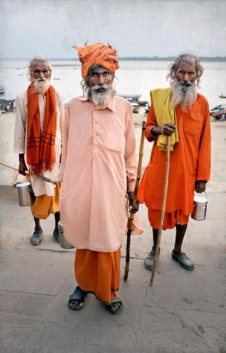 Three Sadhus on morning walk along the Ganges River, India