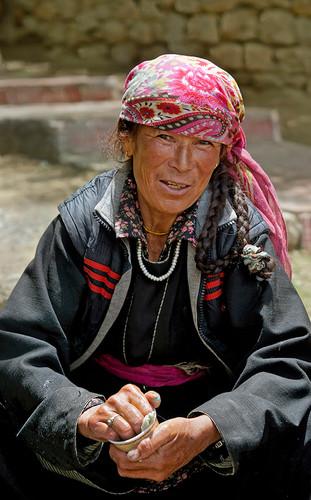 Woman Washing Monastery Tea Cups;  Ladakh, India