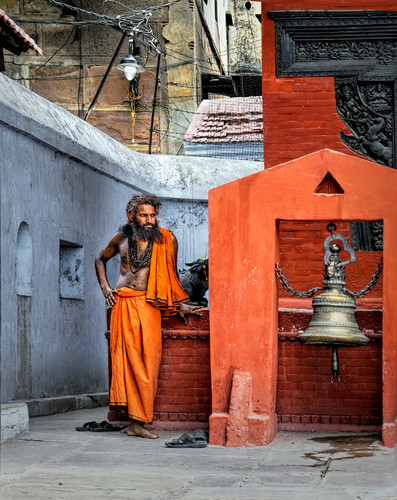 A Monk in his temple's courtyard; Varanasi, India