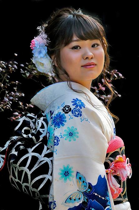 Young woman wearing traditional kimono and obi; Takayama, Japan