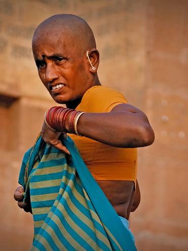 Pilgrim on a Ghat of the Ganges; Varanasi, India