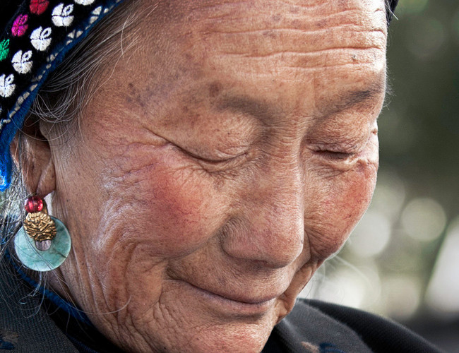Bai Woman, Reflective Moment; Zhoucheng,China