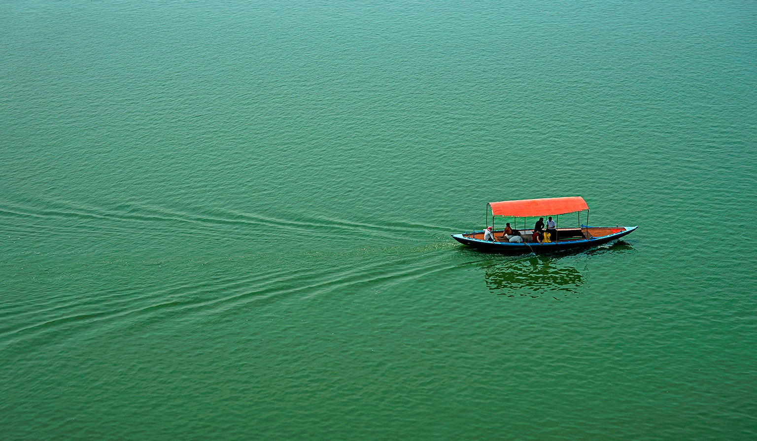 Covered Wooden Boat on Ganges; India