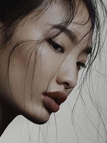 Asian woman with bright and even facial skin tone