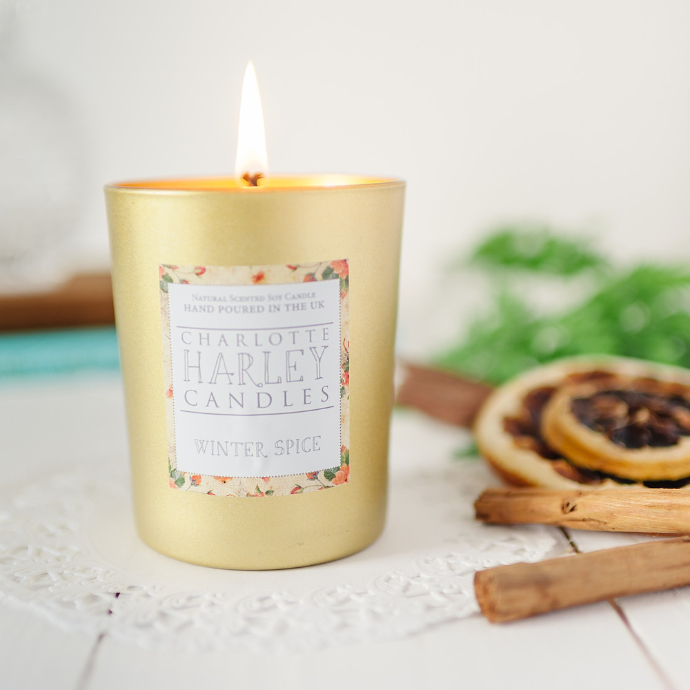 A lit Charlotte Harley Winter Spice candle