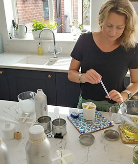Charlotte making candles