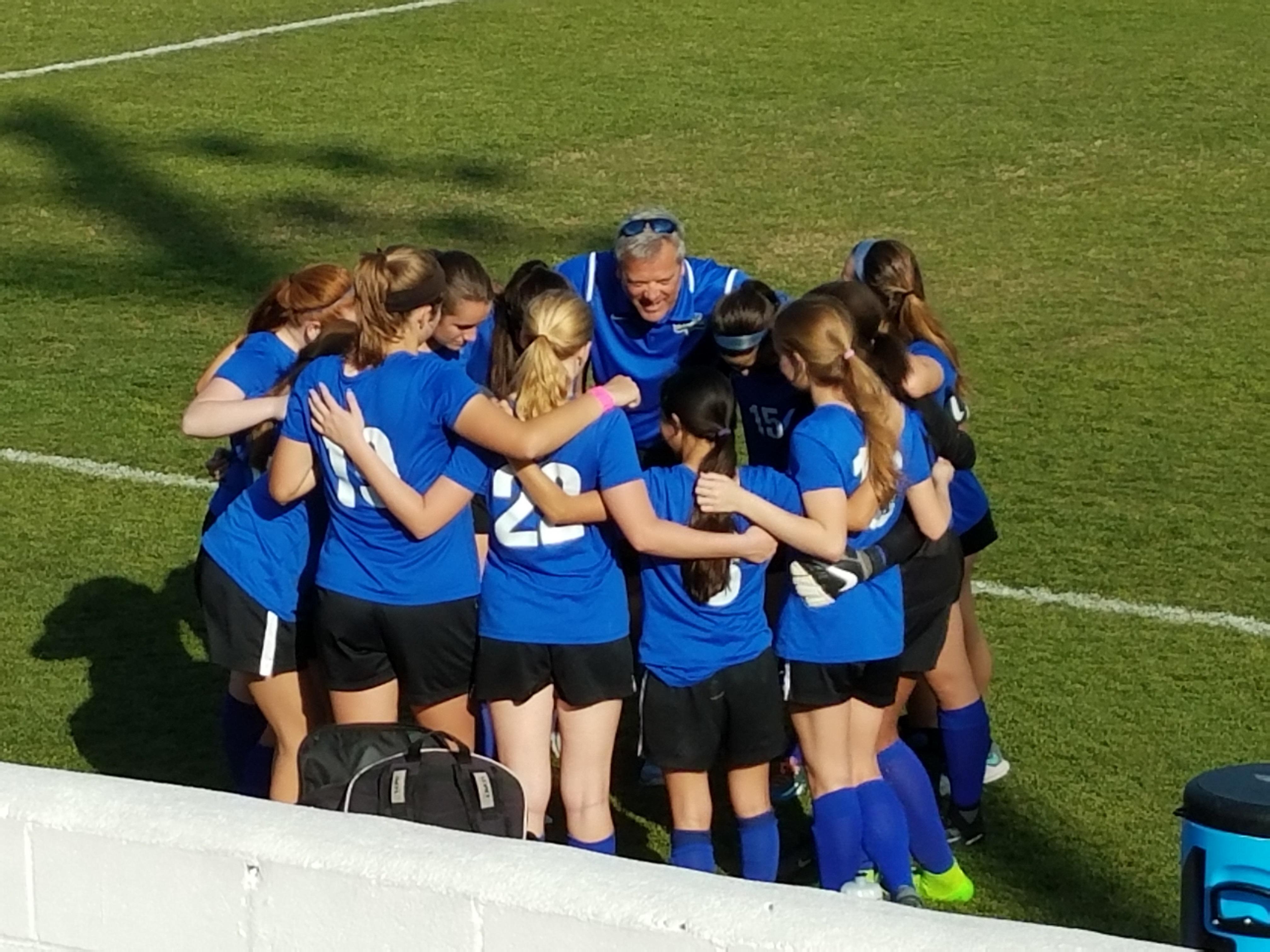 G Soccer Team Huddle