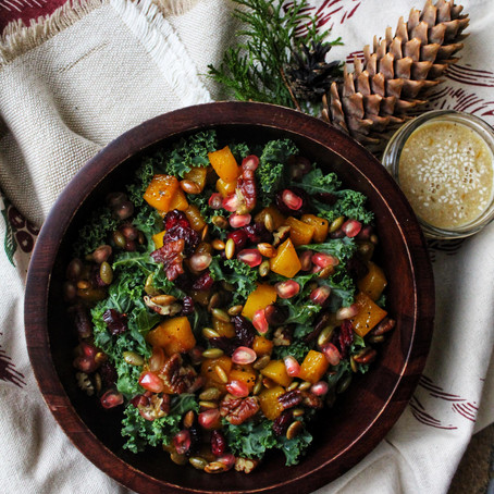 Warm kale salad with butternut squash, nuts and winter fruits