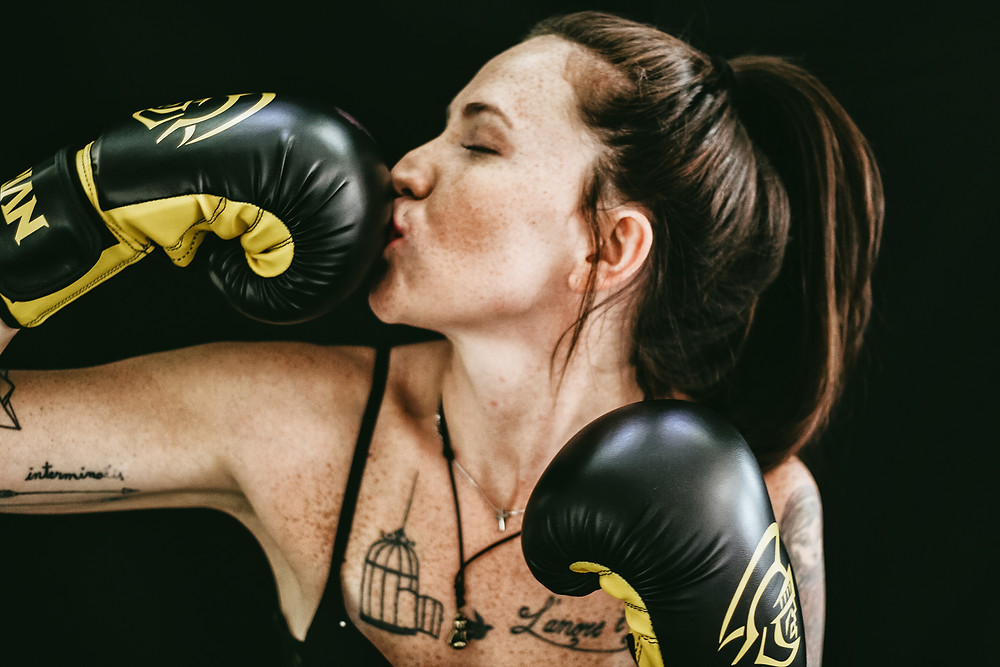 Lady boxer kissing her glove