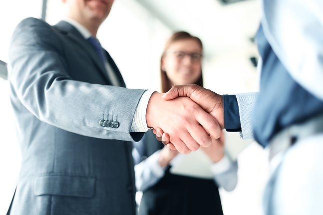Business people shaking hands, finishing