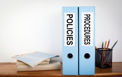 Policies and Procedures binders in the o