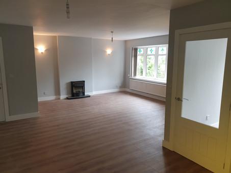 Gray flooring lounge front door.jpg