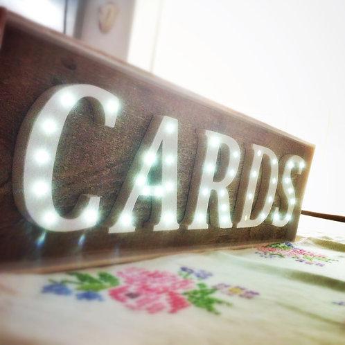 ILLUMINATED CARDS SIGN