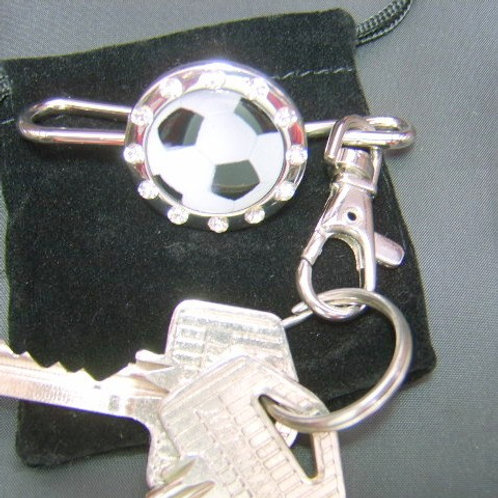 football key finder with white stones