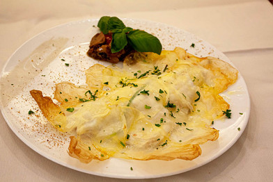 Filetto di spigola su crosta di patate