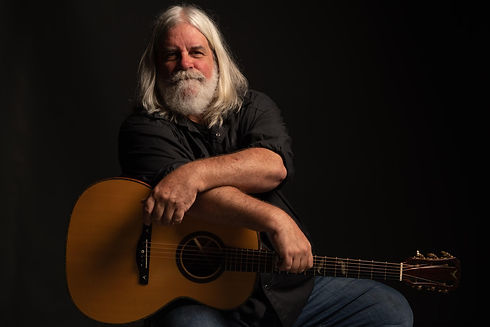 portrait photo of Vince Herman with guitar