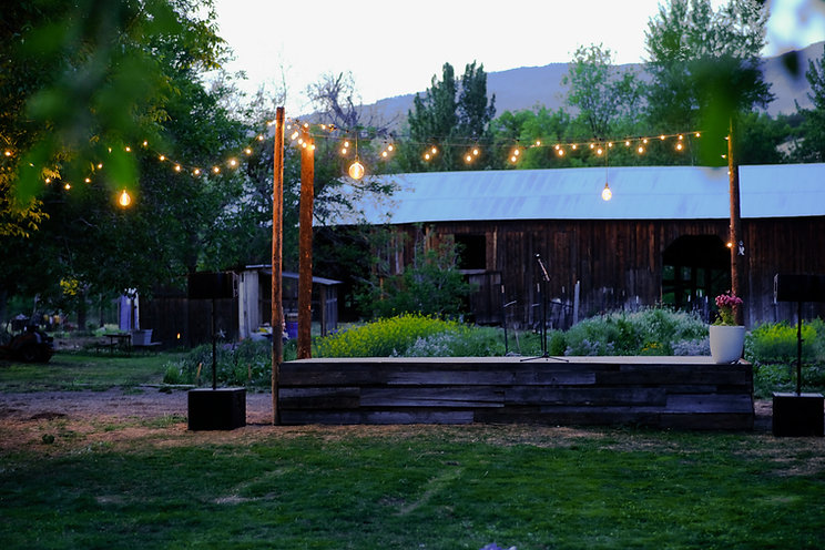 photo of stage in front of historic barn