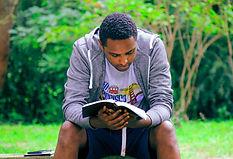 man reading bible park bench.jpg