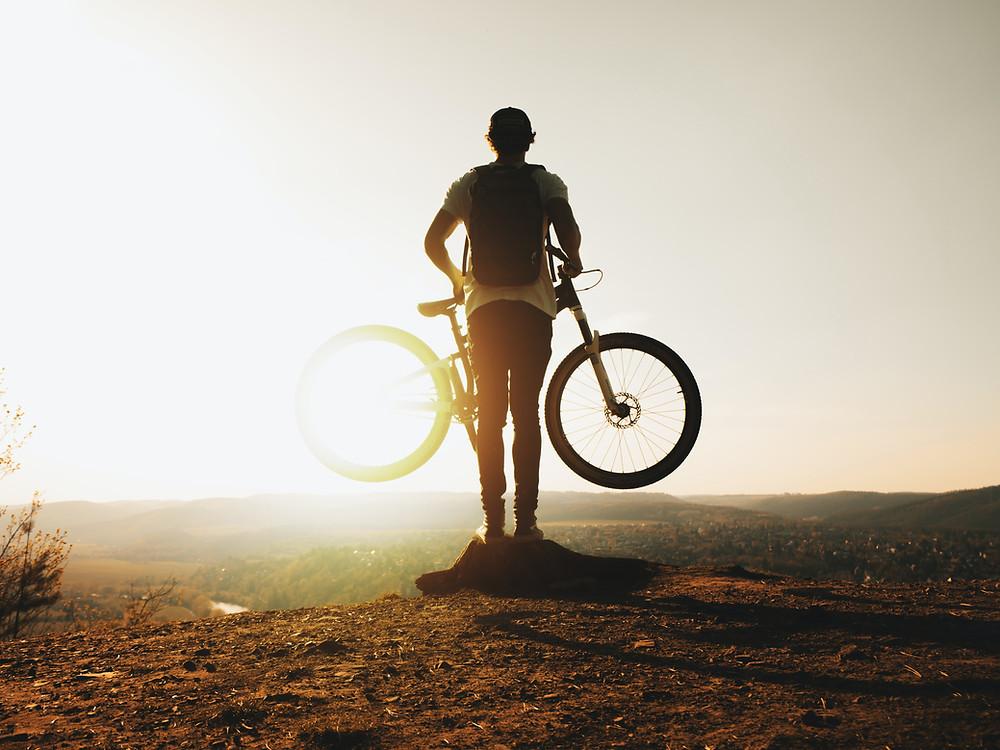 Man riding performance mountain bike